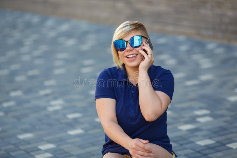 Stylish girl plus sizetalking on the phone royalty free stock photography
