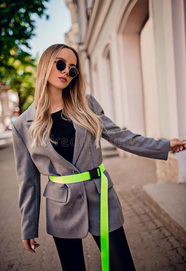 Stylish young woman posing on the street stock photos