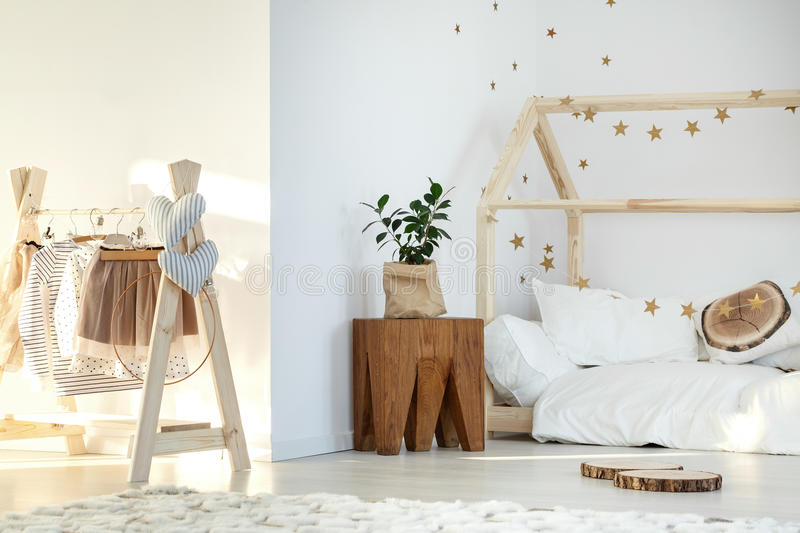 Stylish girl`s room. With bed and wooden accessories stock photos