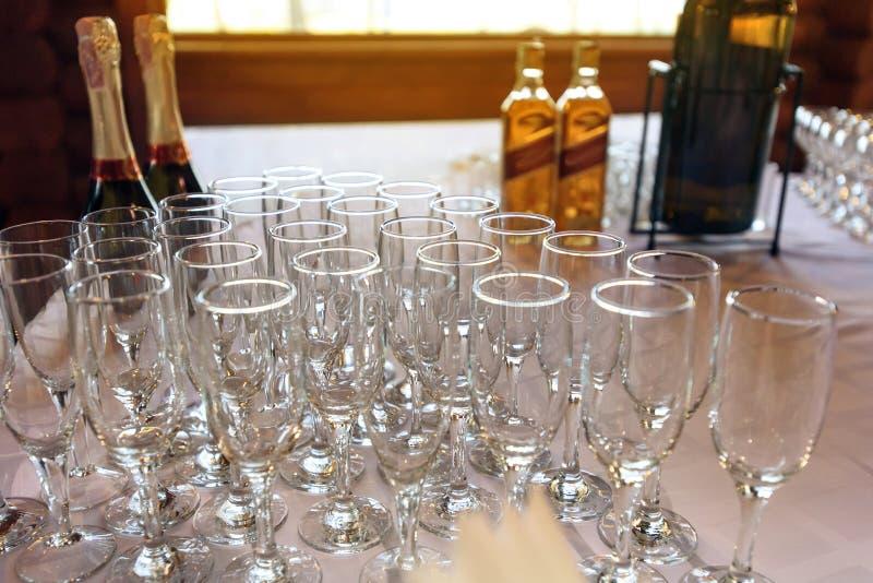 Stylish glasses at alcohol bar table at luxury wedding reception royalty free stock image