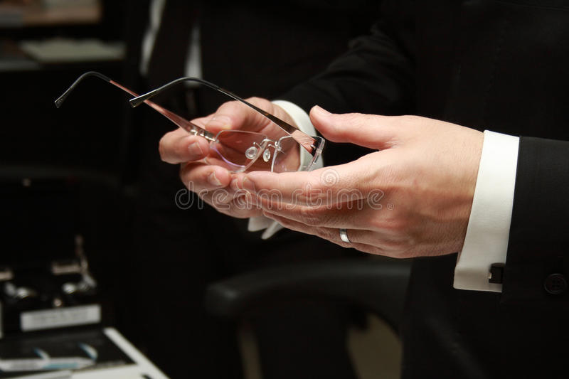 Download Stylish Glasses In The Man's Hands Stock Photo - Image: 10834364