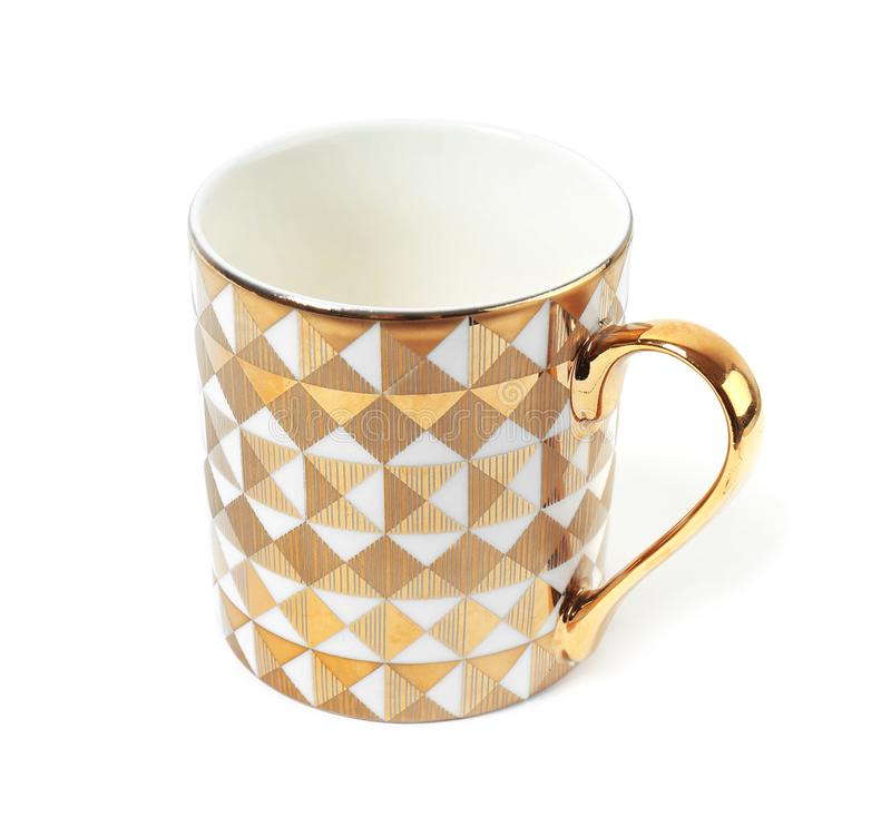 Stylish gold cup with pattern on white royalty free stock photography