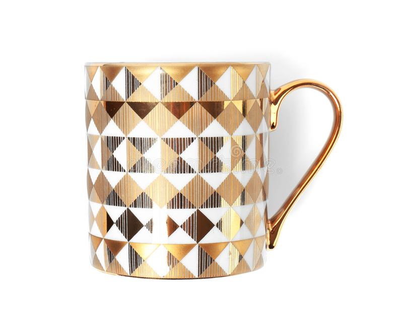 Stylish gold cup with pattern on white background royalty free stock photography