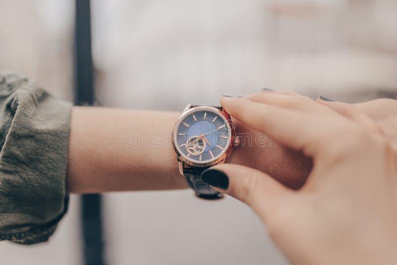 Stylish golden watch on woman hand stock image