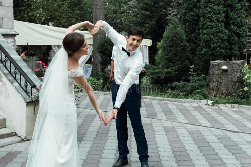 Stylish gorgeous happy bride and elegant groom performing their stock photo