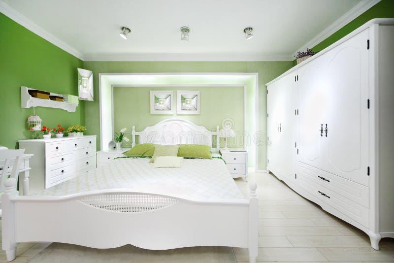 Download Stylish green bedroom stock photo. Image of mirror, design - 28023906