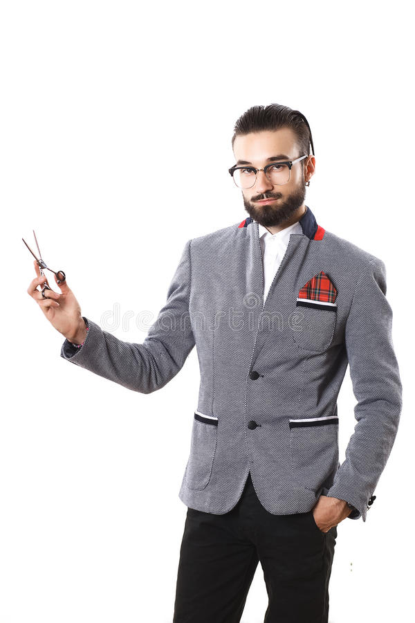 Stylish guy advertises scissors. hairstyle concept stock photography