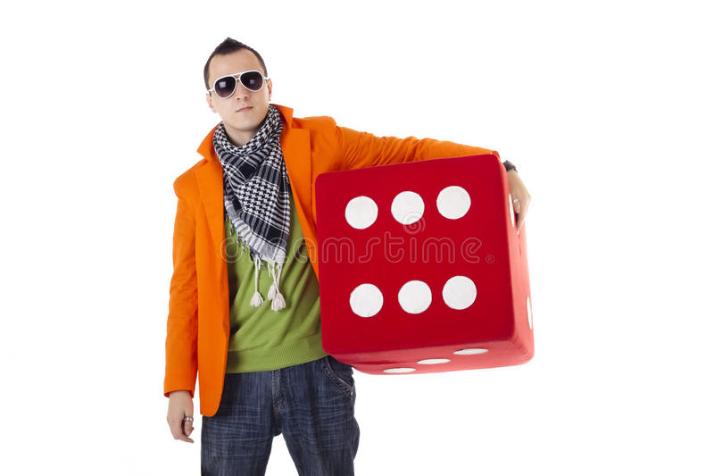 Stylish guy with glasses holding dice royalty free stock photos