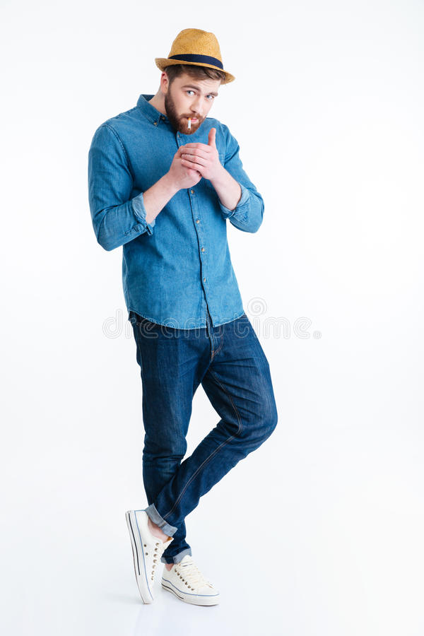 Stylish handsome bearded man is going to smoke stock photography