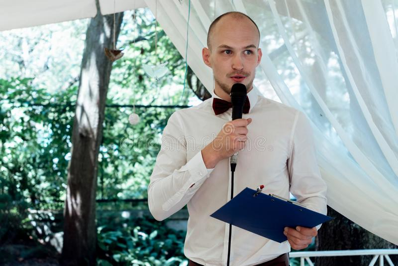 Stylish handsome emcee performing speech for toast at wedding re royalty free stock photos