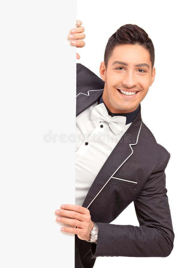 Download A Stylish Handsome Guy Posing Behind A Blank Panel Stock Photo - Image: 28258980