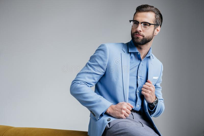 Stylish handsome man in eyeglasses and blue. Trendy suit stock image