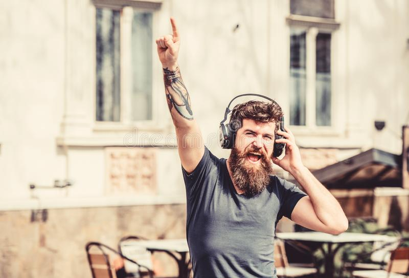 Stylish and handsome music lover. Mature hipster with beard. Man in headphones. Love this music. Good music increases my stock photo