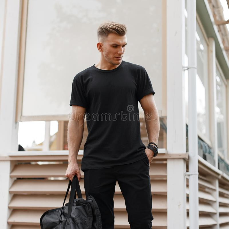 Stylish handsome young american hipster model man with hairstyle royalty free stock photos