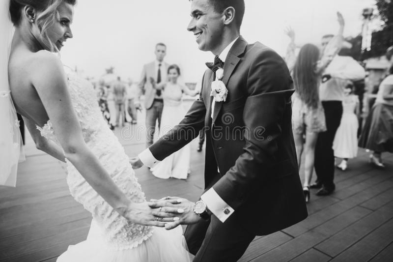 Stylish happy bride and groom having fun and dancing at wedding reception. Gorgeous wedding couple of newlyweds having first dance royalty free stock photos