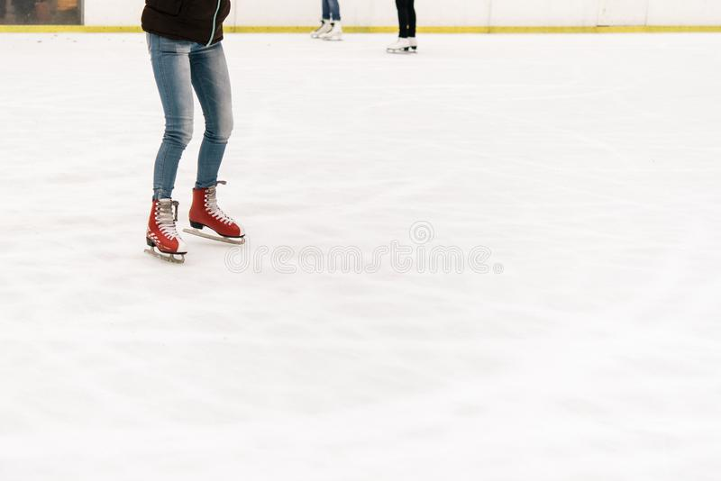 Stylish happy skater on a white skating rink in a city center, h. Ealth activity and celebration holidays concept stock image