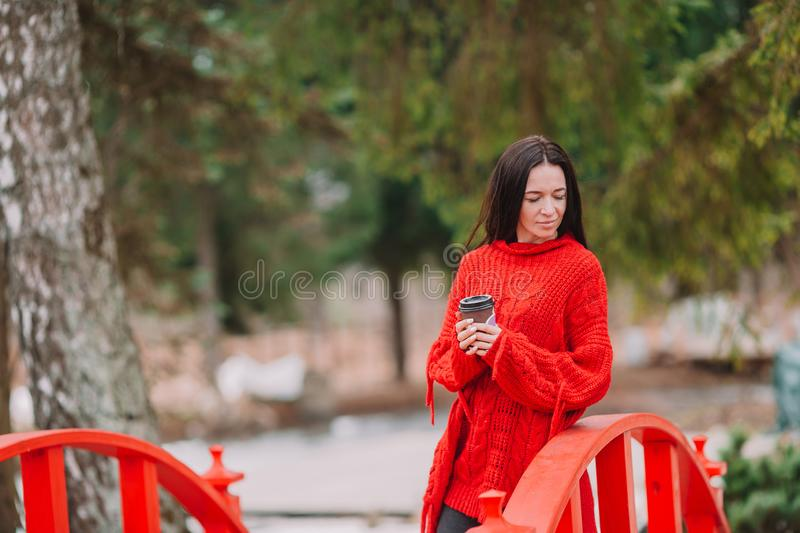 Young stylish woman drinking coffee to go in a city street royalty free stock photos