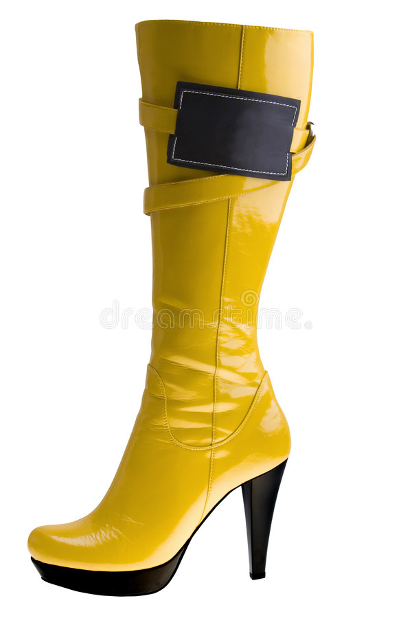 Stylish high heel fashion yellow boot stock images
