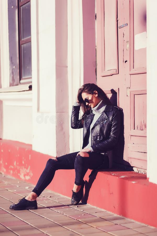 Stylish hipster girl in leather jacket royalty free stock image
