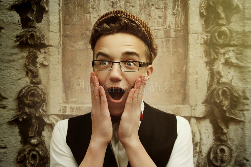 Stylish hipster man laughing and beeing surprised, funny emotion royalty free stock photo