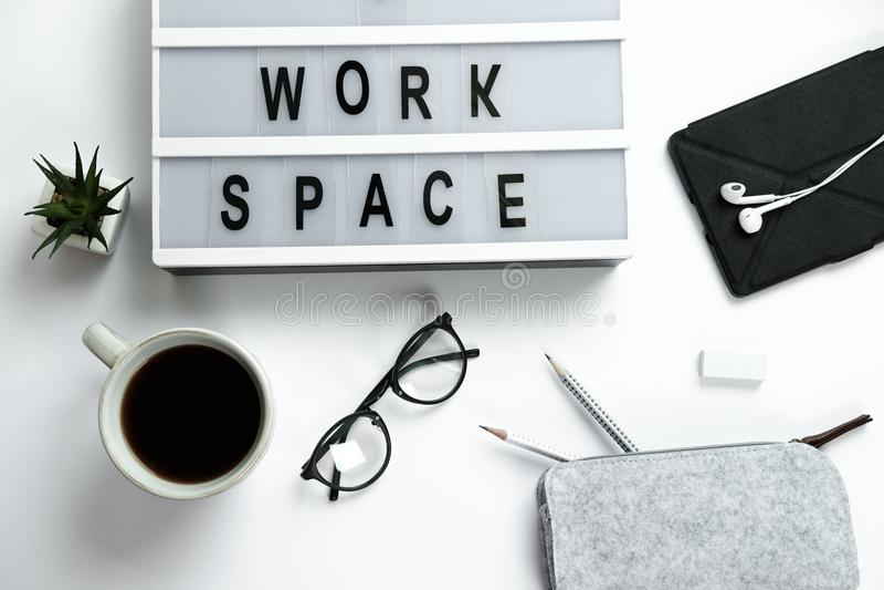 Stylish hipster white desktop top view laptop, coffee, glasses, headphones, pencils, workspace. stock photos