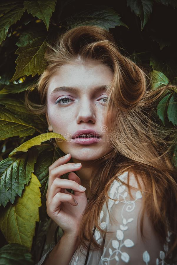 Stylish hipster woman with fern leaf embracing. girl portrait with natural herb, boho sensual bride. romantic moment stock images