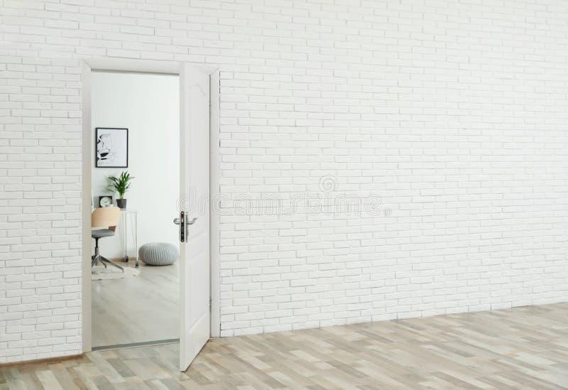 Stylish home office interior, view through open door stock photo