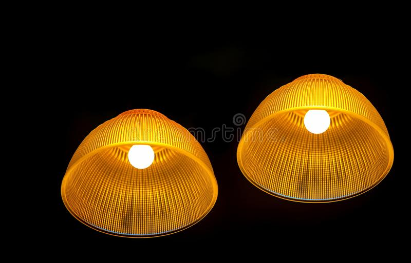 Stylish incandescent light fixtures. Designer incandescent light fixtures hanging from the ceiling stock image