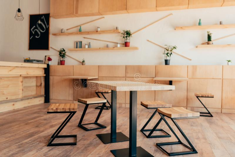 Stylish interior of modern cafe with stylish wooden furniture royalty free stock photography
