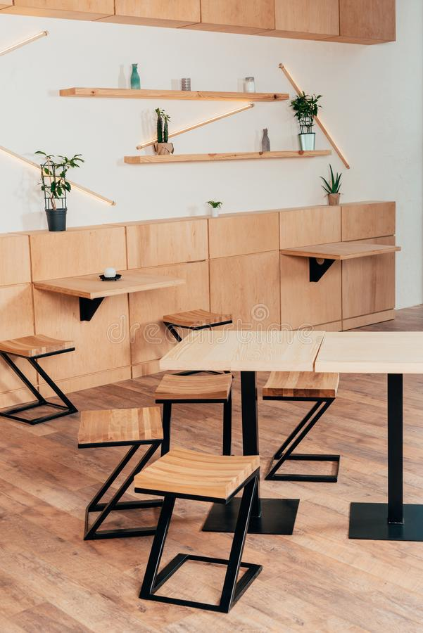 Stylish interior of modern cafe with stylish. Wooden furniture royalty free stock photos