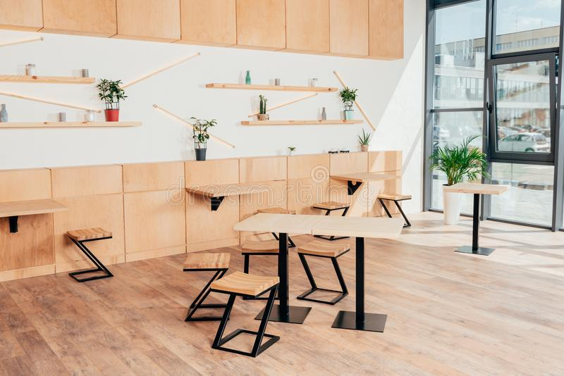 Stylish interior of modern cafe with stylish. Wooden furniture royalty free stock photography