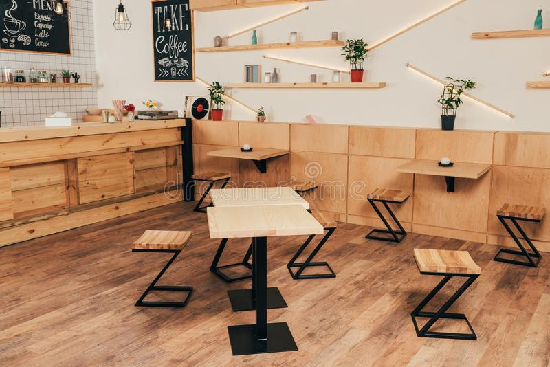 Stylish interior of modern cafe with stylish. Wooden furniture stock images