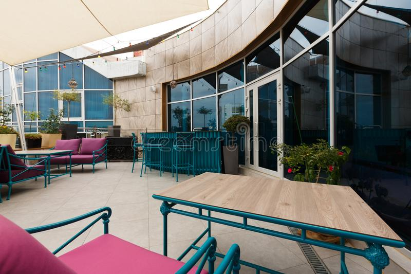 Stylish interior of modern restaurant. Modern cafe interior. Light walls and bright furniture in stylish restaurant design, copy space stock photos