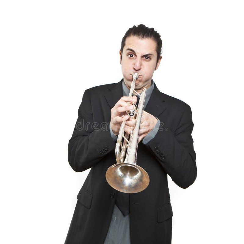 Stylish jazz man playing the trumpet