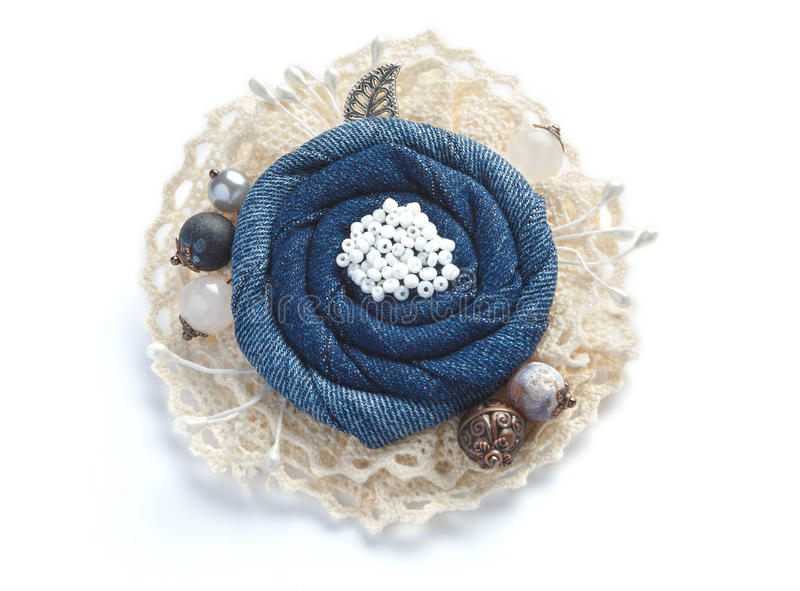 Stylish jean brooch handmade on white background royalty free stock image