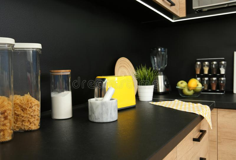 Stylish kitchen counter with houseware, appliances. And products stock photography