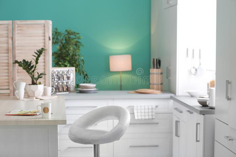Stylish kitchen interior setting. Idea for home. Design stock photography