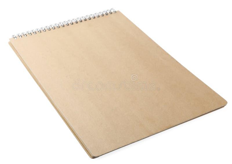 Stylish kraft spiral notebook on white. Stylish kraft spiral notebook isolated on white stock photos