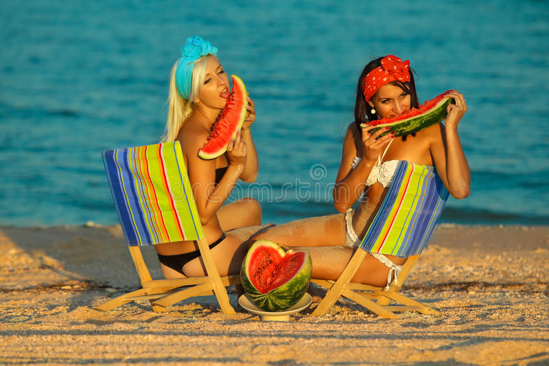 Download Stylish Ladies At Sea With Watermelon Stock Image - Image: 26636365