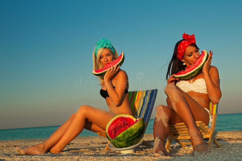 Download Stylish Ladies At Sea With Watermelon Stock Photo - Image: 26998416