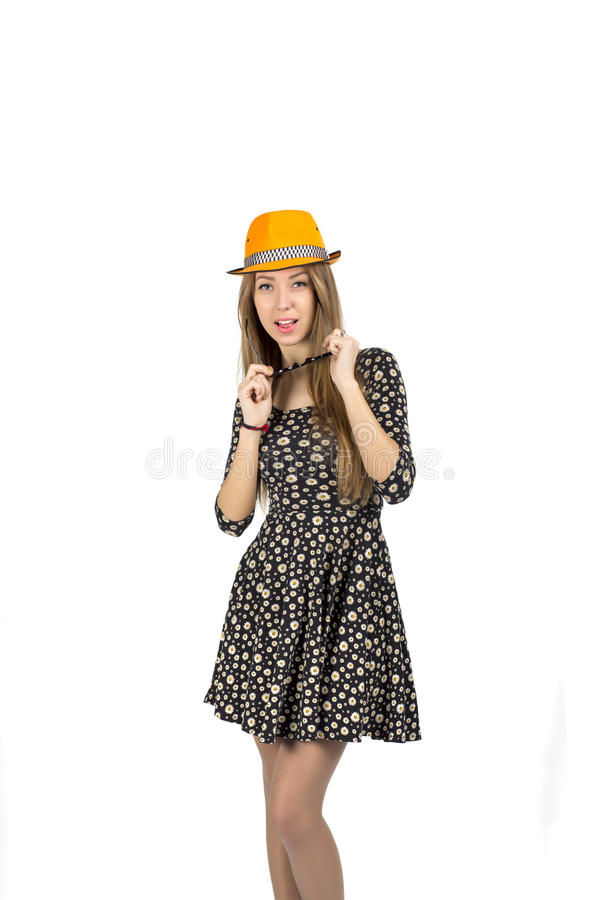 Stylish lady in orange hat. Young Caucasian female in stylish hat and sunglasses expresses ardor and energy stock image