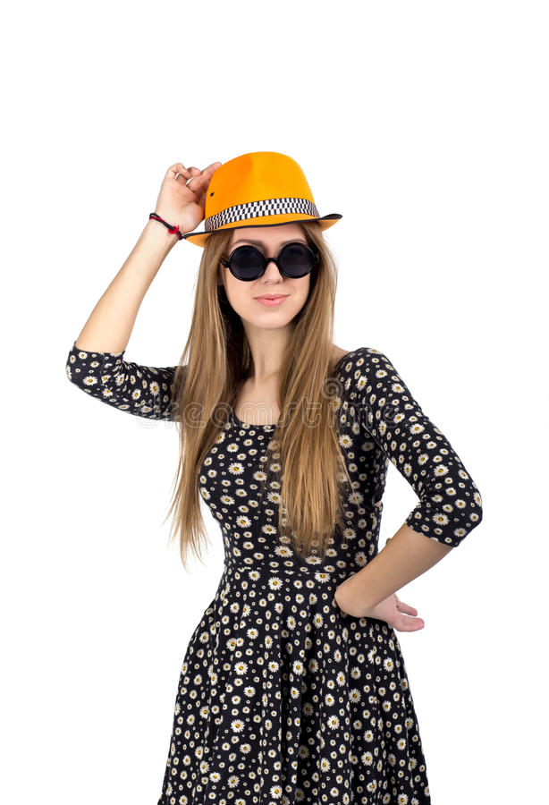 Stylish lady in orange hat. Young Caucasian female in stylish hat and sunglasses expresses ardor and energy royalty free stock image