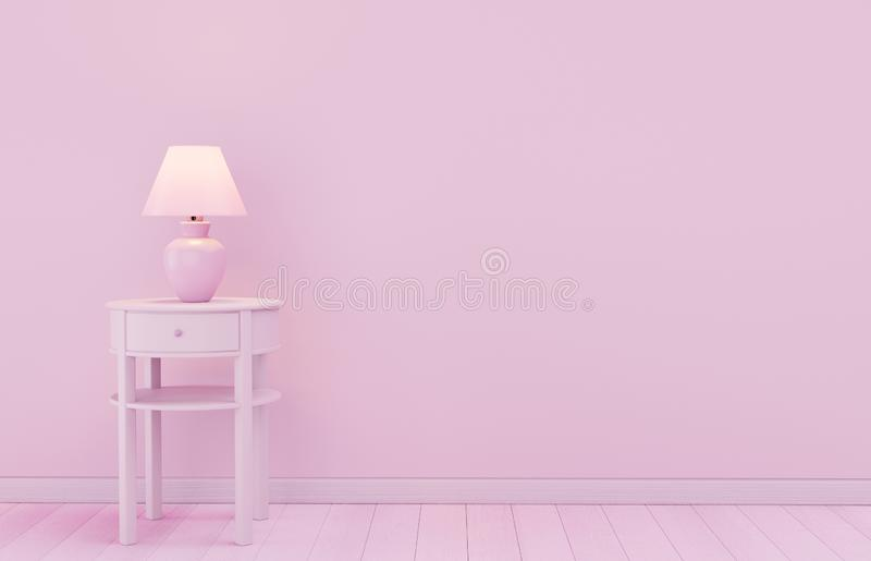 Stylish lamp on table against color wall, space for text. royalty free stock photo