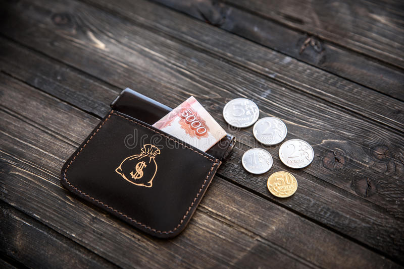 Stylish leather wallet with money and box on wooden background.  stock image