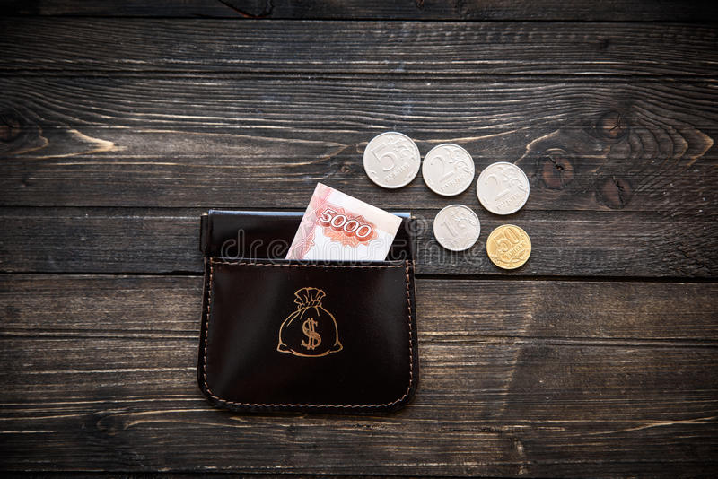 Stylish leather wallet with money and box on wooden background.  stock images