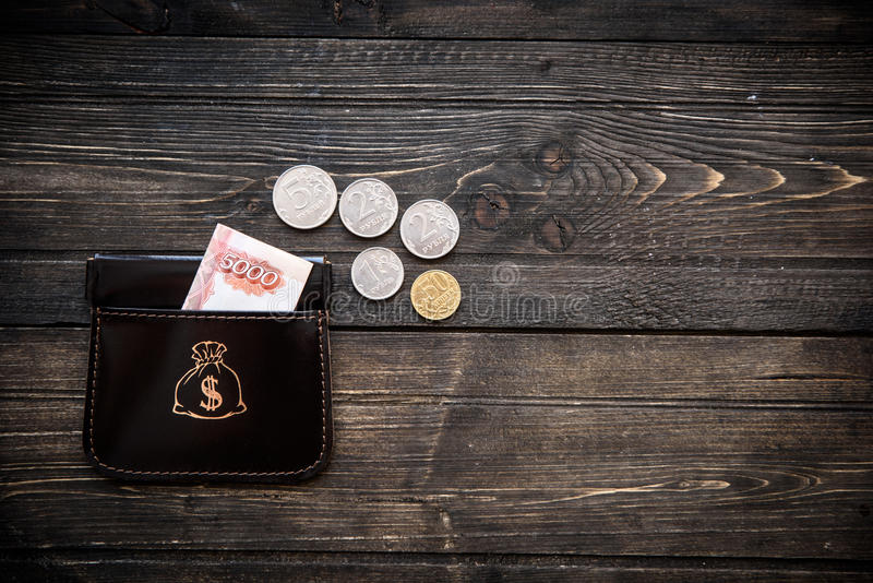 Stylish leather wallet with money and box on wooden background.  stock photography