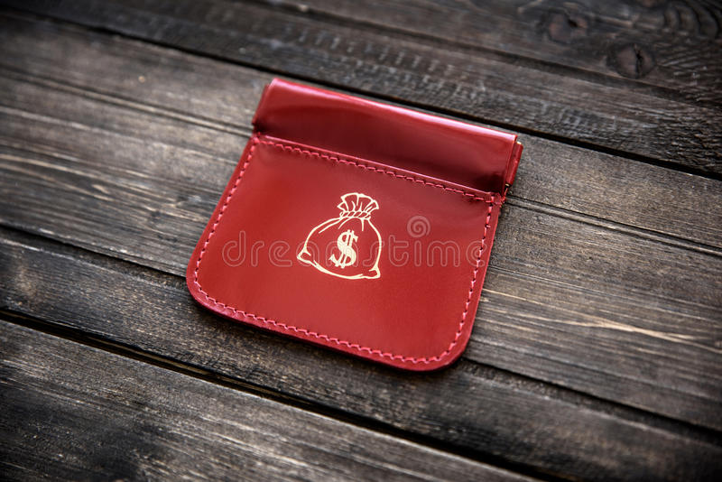 Stylish leather wallet with money and box on wooden background.  royalty free stock photography