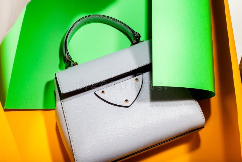 Stylish leather women handbag bag on a stylish bright fashion background. Stylish leather women handbag bag with handle on a stylish bright fashion background stock images