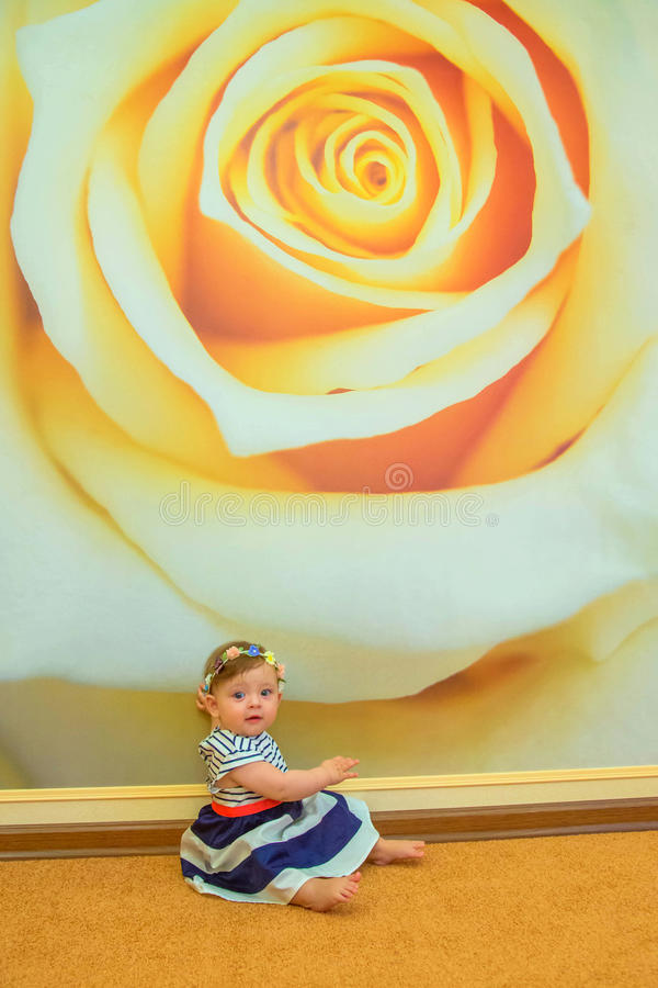 Stylish little baby girl in the nursery. stock images