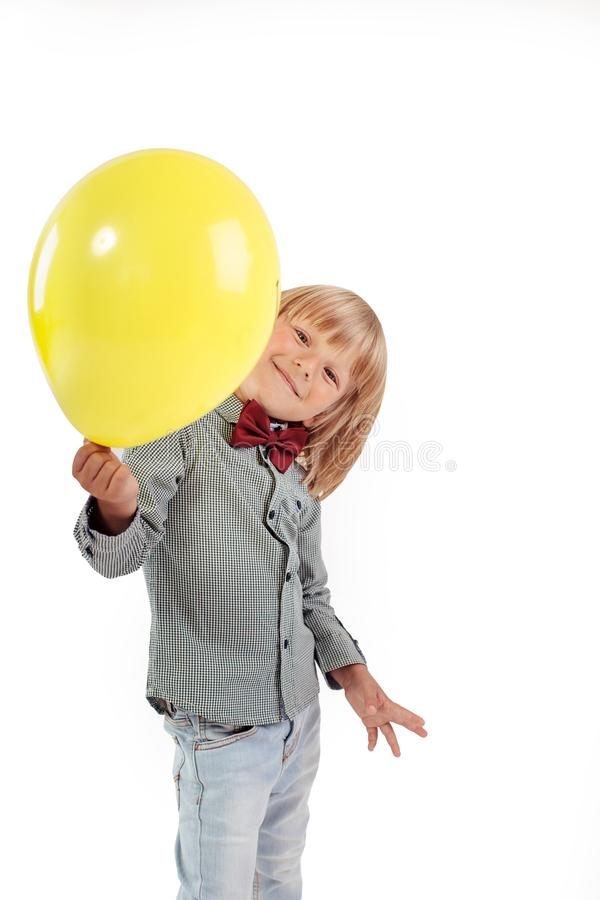 Free Stylish Little Boy Dressed In Red Bow Tie Holding Air Balloon Isolated On White Background. Royalty Free Stock Images - 110749389